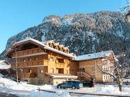 Apartmajsko hiša se nahaja v v predelu Fontanazzo, 800 m od centra Campitella in 1,2 km od gondole Col Rodela, ki vas odpelje v v smučarski sistem Sella Ronde.